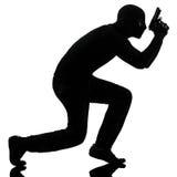 Verticale criminelle de canon de fixation de terroriste de voleur images libres de droits