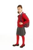 Verticale d'étudiant féminin dans l'uniforme Photographie stock libre de droits