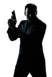 Verticale d'homme de silhouette avec le canon Photographie stock
