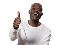 Verticale d'homme heureux affichant des pouces vers le haut Photo stock