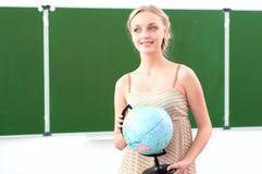 Verticale d'un beau professeur féminin Photographie stock