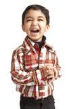 Verticale d'un enfant en bas âge riant photos libres de droits