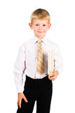 Verticale d'un garçon formel de sourire avec des livres images stock