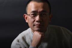 Verticale d'un homme asiatique Photo stock