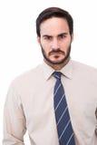 Verticale d'un homme d'affaires fâché Photo libre de droits