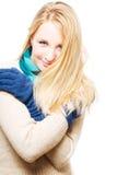 Verticale d'un jeune femme heureux dans gants chauds Image stock