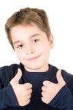Verticale d'un jeune garçon satisfaisant photographie stock