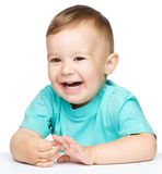 Verticale d'un petit garçon gai mignon Image stock
