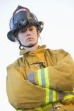 Verticale d'un sapeur-pompier féminin photographie stock
