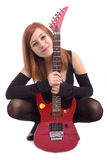 Verticale d'une adolescente avec la guitare photographie stock
