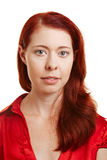 Verticale d'une femme redhaired Photos stock