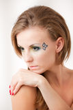 Verticale d'une fille avec les yeux colorés Photo libre de droits
