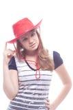 Verticale d'une fille dans un chapeau rouge Photographie stock