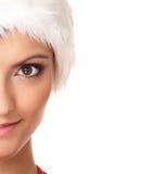Verticale d'une jeune et sexy Santa femelle Photographie stock libre de droits