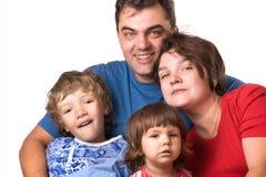 Verticale d'une jeune famille Photo stock