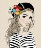 Verticale d'une jeune femme avec des fleurs illustration libre de droits