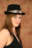 Verticale d'une jeune fille avec le chapeau Photos stock