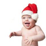 Verticale de bébé dans le chapeau de Noël Photos libres de droits