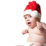 Verticale de bébé dans le chapeau de Noël Images libres de droits