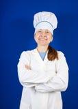 Verticale de cuisinier féminin de sourire Images libres de droits