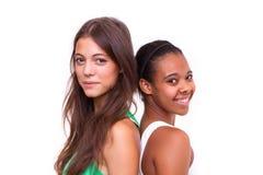 Verticale de deux filles différentes de nationalités Photo libre de droits