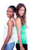 Verticale de deux filles différentes de nationalités Images stock