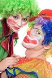 Verticale de deux ou trois clowns Images libres de droits