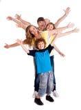 Verticale de famille gaie de trois rétablissements Photo stock