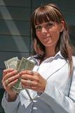 Verticale de femme avec des dollars Images libres de droits