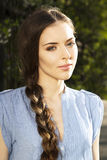 Verticale de fille avec la tresse Photos stock