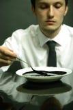 Verticale de gestionnaire de bureau mangeant le pétrole Photos libres de droits