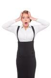 Verticale de jeune femme d'affaires stupéfaite Photo stock