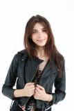 Verticale de jeune femme dans la jupe en cuir Image libre de droits
