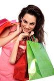 Verticale de jeune fille avec des sacs à provisions Image stock