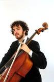 Verticale de jeune homme avec le violoncelle Photos libres de droits