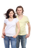 Verticale de jeunes couples dans des jeans Photos libres de droits