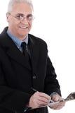 Verticale de l'écriture de sourire d'homme d'affaires sur la garniture Images libres de droits