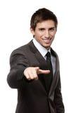 Verticale de l'homme de sourire d'affaires se dirigeant à vous image libre de droits