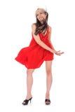Verticale de la fille dans une robe rouge images stock