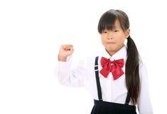 Verticale de petite écolière asiatique Photographie stock