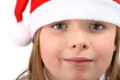 Verticale de petite fille dans le chapeau de Santa d'isolement Images libres de droits