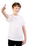 Verticale de plan rapproché de pouces affichants de l'adolescence vers le haut Photos stock