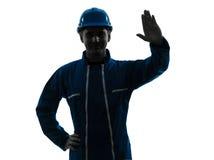 Verticale de silhouette de vêtements de travail de construction d'homme photo stock