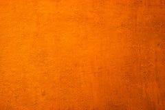 Verticale de textuurachtergrond van de grunge oranje muur Royalty-vrije Stock Afbeelding