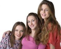 Verticale de trois jeunes filles heureuses Photo stock