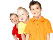 Verticale des enfants heureux d'isolement sur le blanc Photographie stock