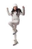 Verticale dynamique de saut de femme caucasien Photo stock