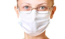 Verticale femelle de docteur dans le masque Image stock