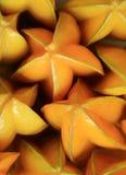 Verticale foto van vele trillende Vruchten van de kleuren rijpe Ster Stock Fotografie