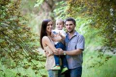 Verticale heureuse de famille Photographie stock